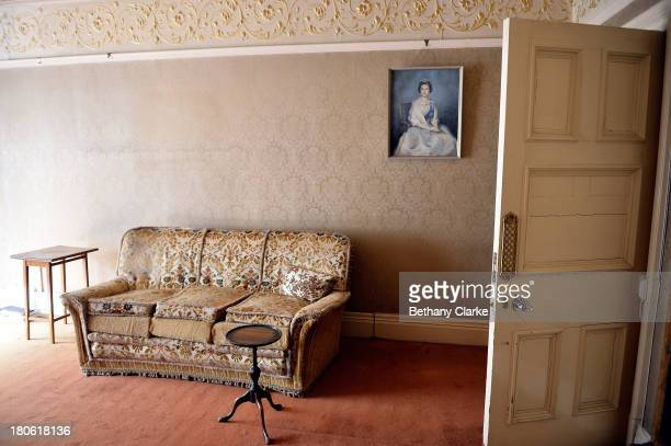 A picture of Queen Elizabeth II hangs in the drawing room in Pineheath house on September 4 2013 in Harrogate England The untouched 40bedroom house...