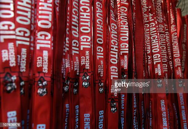 picture of red ribbons reading slogans related to the folk saint Gauchito Gil sold outside his sanctuary in Mercedes in the Argentine province of...