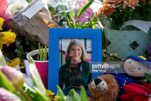 Picture of Sarah Everard sits amongst flowers left at the bandstand, Clapham Common where floral tributes have been building up over the last few...