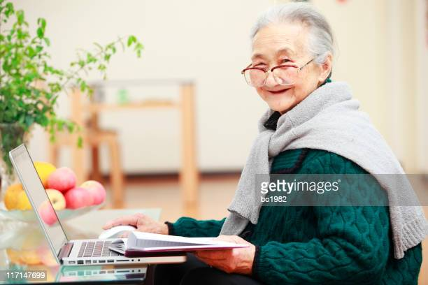 picture of senior asian woman using laptop