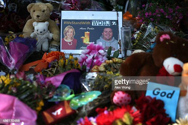 A picture of slain WDBJ photojournalists Adam Ward and Alison Parker is seen at a make shift memorial outside the station September 1 2015 in Roanoke...