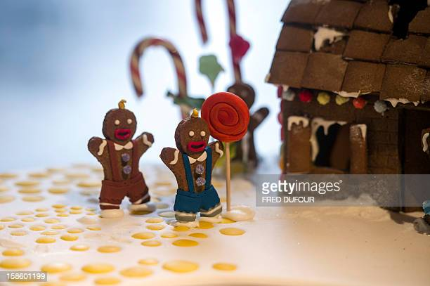 Picture of small characters on a Christmas cake taken on December 20 2012 in Paris at the Sugarplum Cake Shop an authentic American Coffee Shop AFP...