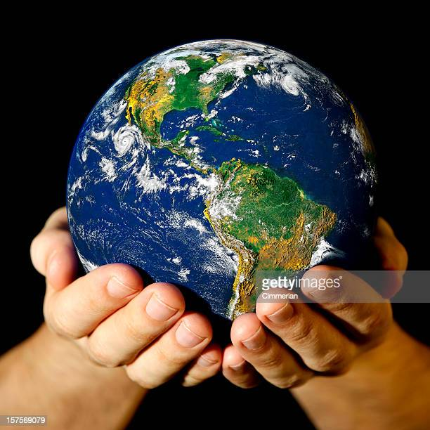 A picture of someone holding a mini world in their hands
