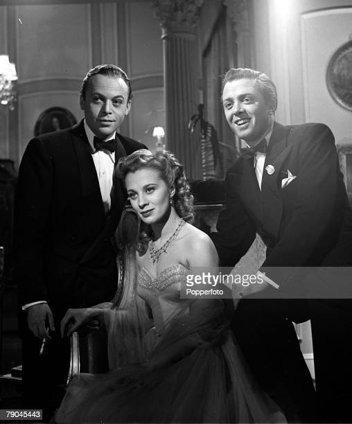 1950 A picture of Swedish actress Mai Zetterling flanked by British actors Herbert Lom and Richard Attenborough on the set of the film Hell is Sold...