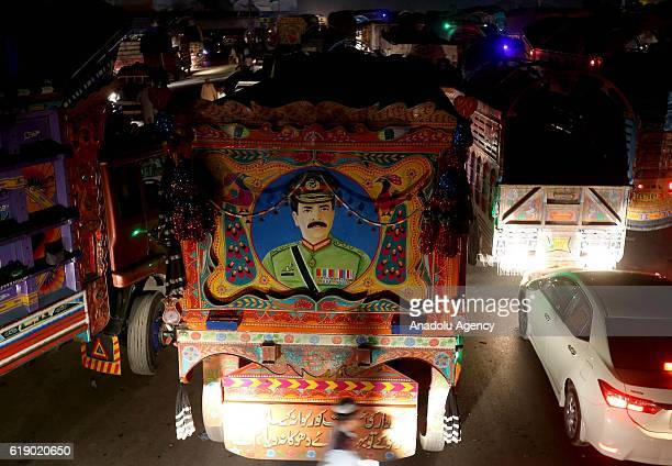 Picture of the Chief of Army Staff of the Pakistan Army Raheel Sharif is seen on a truck as containers are placed on the highways leading to...