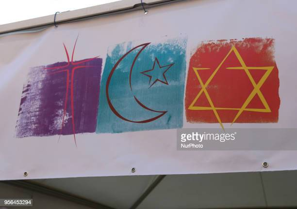 A picture of the christian cross the islamic crescent moon and a jewish star of David is seen on the Leopoldcorso in Munich Germany on May 9 2018