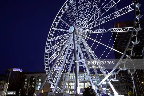 A picture of the city center Ferris wheel at night