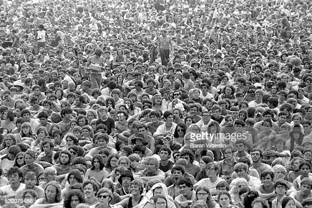 A picture of the crowd attending the Woodstock Music Art Fair a mass music festival billed as 'An Aquarian Exposition 3 Days of Peace Music' Bethel...