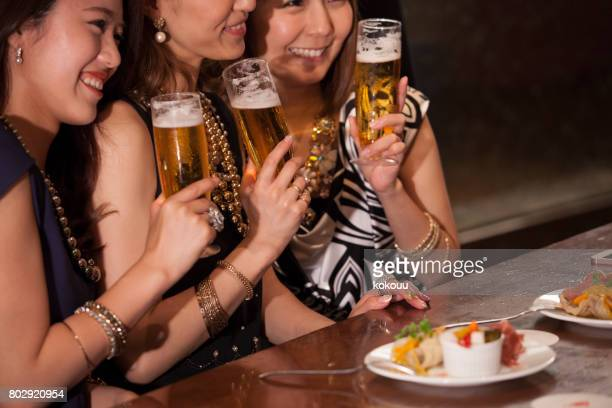 A picture of the female college students in the city bar.