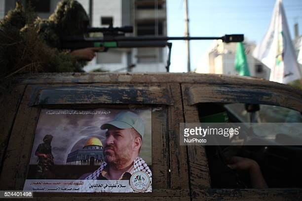 Picture of the late Hamas military commander Ahmed Al-Jaabari stuck on a military truck during a parade for militants of the Ezzedine al-Qassam...