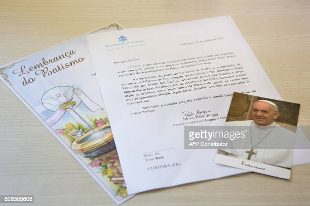 Picture of the letter a certificate of baptism and a card depicting Pope Francis sent by the Vatican in July to the gay couple constituted by...