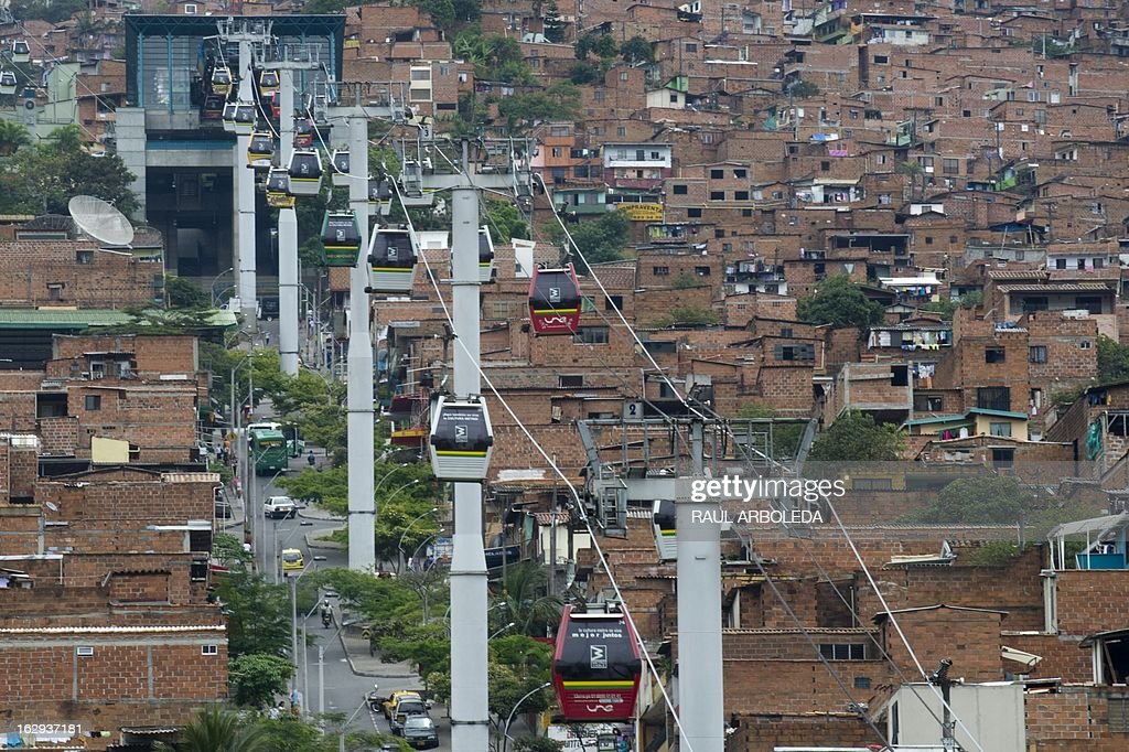 "Picture of the Metrocable, in Santo Domingo Savio neighbourhood, in Medellin, Antioquia department, Colombia on March 1, 2013. Medellin, which competed with New York and Tel Aviv, was chosen by popular vote through the internet, as the ""Innovative City of the Year"" during the City of the Year contest, organized by The Wall Street Journal and Citigroup. The distinction was basically made for its modern transportation system, its public library, escalators built in a shantytown and schools that have allowed the integration of society. AFP PHOTO/Raul ARBOLEDA"