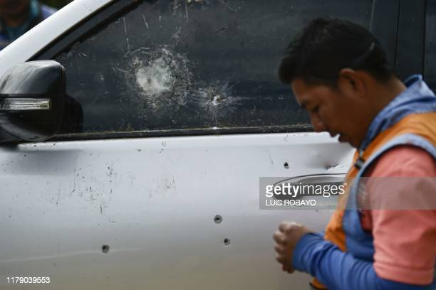 Picture of the shattered window and bullet holes in the vehicle in which indigenous guards were driving while being attacked by suspected rebels...