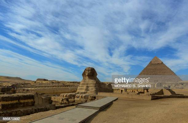 TOPSHOT A picture of the Sphinx at the Giza Pyramids complex on the outskirts of the Egptian capital Cairo on December 6 2017 / AFP PHOTO / MOHAMED...