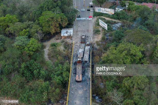 TOPSHOT Picture of the three aid trucks which were set ablaze on February 23 2019 on the Venezuelan side of the Simon Bolivar International Bridge in...