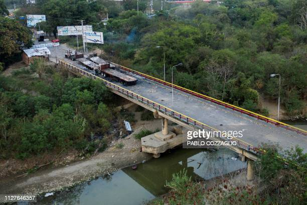 Picture of the three aid trucks which were set ablaze on February 23, 2019 on the Venezuelan side of the Simon Bolivar International Bridge in San...