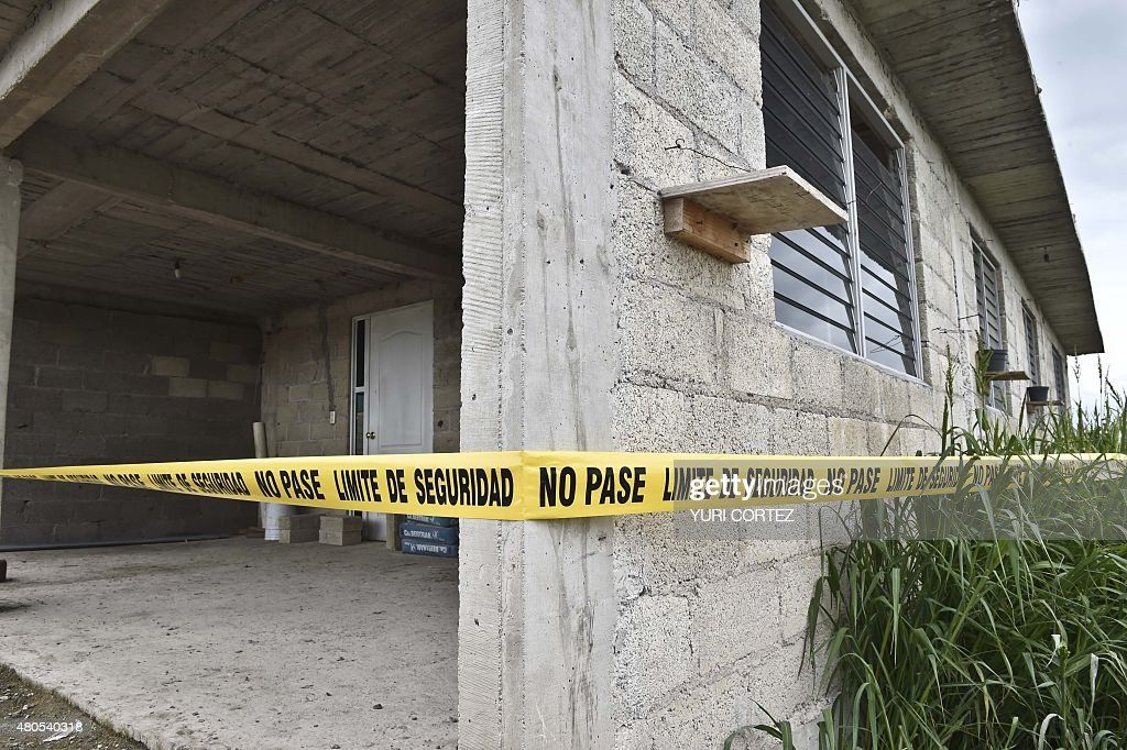 Picture of the yellow tape put by security forces of the Office of the Attorney General around the house at the end of the tunnel through which Mexican drug lord Joaquin 'El Chapo' Guzman could have escaped from the Altiplano prison, in Almoloya de Juarez, Mexico, on July 12, 2015. Guzman has escaped from a maximum-security prison, the government said Sunday, his second jail break in 14 years. The kingpin was last seen in the shower area of the Altiplano prison in central Mexico late Saturday before disappearing. 'The escape of Guzman was confirmed', the National Security Commission said in a statement.