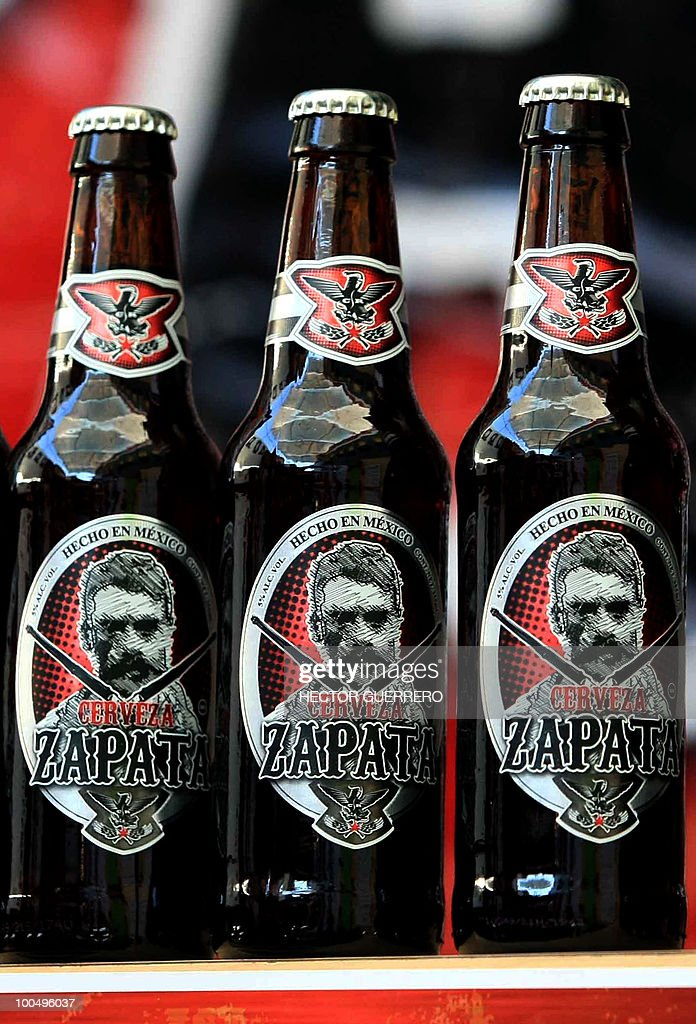 Picture of three bottles of beer with the image of late Mexican Revolutionary leader Emiliano Zapata displayed during a press conference in Guadalajara on May 20, 2010. Revolution Brewing Company announced this and other product lines alluding to the centenary of the Mexican Revolution. AFP PHOTO/Hector Guerrero