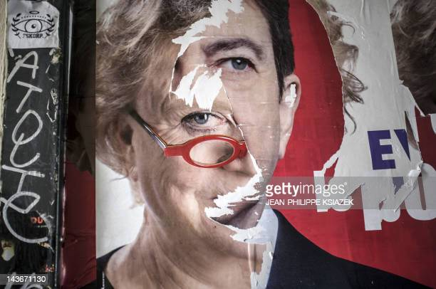 """Picture of torn campaign posters of French Green Party """"Europe Ecologie Les Verts"""" candidate Eva Joly and of Front de gauche leftist candidate..."""