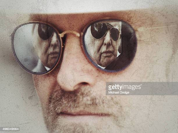 A picture of trainer Bart Cummings is seen in the reflection of glasses during the Melbourne Spring Racing Carnival at Flemington Racecourse on...