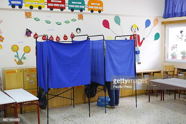 Picture of two voting booths Less then a month after the failure of the Greek Government to elect a new President the Greeks are called to elect a...