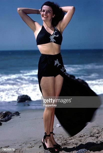 6a3df09656172 1954 A picture of US film actress Jane Russell posing on a beach in her  bathing