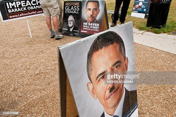 A picture of US President Barack Obama with a Hitlerlike mustache is seen at a stand of controversial politician Lyndon LaRouche's movement during a...