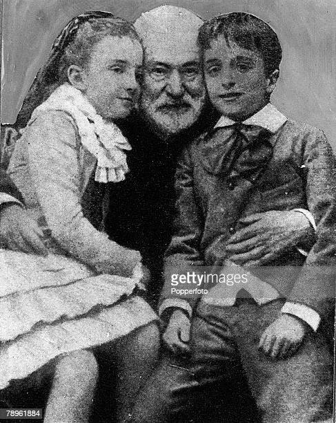 A picture of Victor Hugo the French poet and writer seen here with two of his Grandchildren