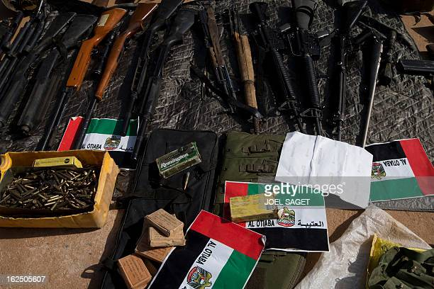 Picture of weapons and ammunitions seized from Islamist fighters exhibited with flags from the United Arab Emirates by the Malian army in the centre...