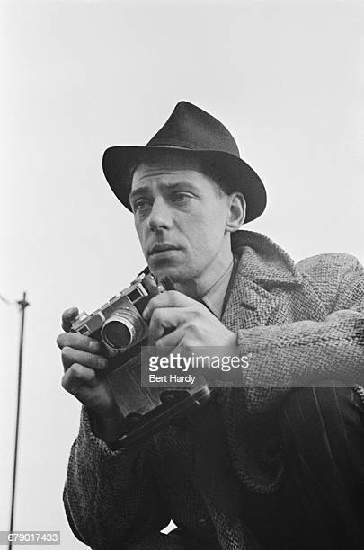 Picture Post photographer Bert Hardy on an assignment February 1941 He is using a Contax II 35 mm rangefinder camera Original Publication Picture...