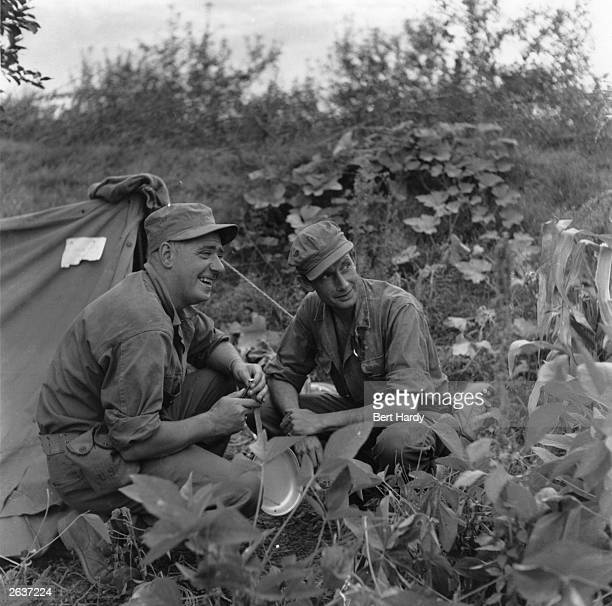 Picture Post photographer Bert Hardy, with journalist James Cameron, covering front line troop movements during the Korean War. Original Publication:...