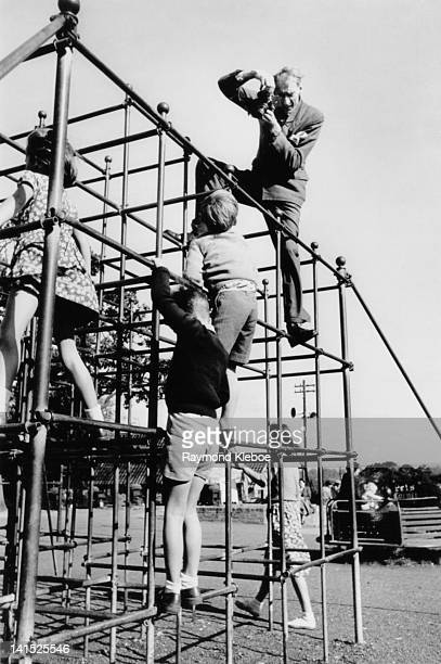 Picture Post photographer Charles Hewitt photographs a group of children from the top of a climbing frame circa 1948 Original publication Picture...
