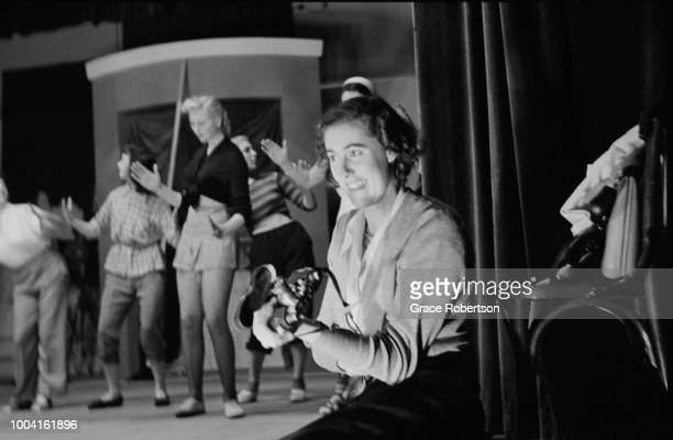 A member of a newlyformed Bluebell Girls dance troupe from England taking photos during a rehearsal at the Nuevo Teatro in Milan November 1951...