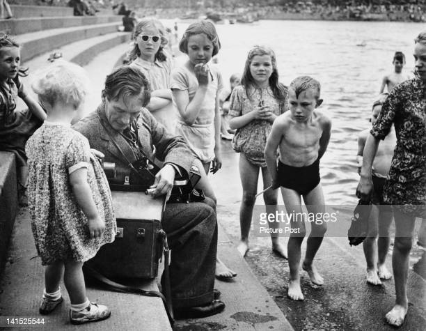 Picture Post photographer Haywood Magee on an assignment circa 1955 Original publication Picture Post 8994 Last Issue pub 1st June 1957