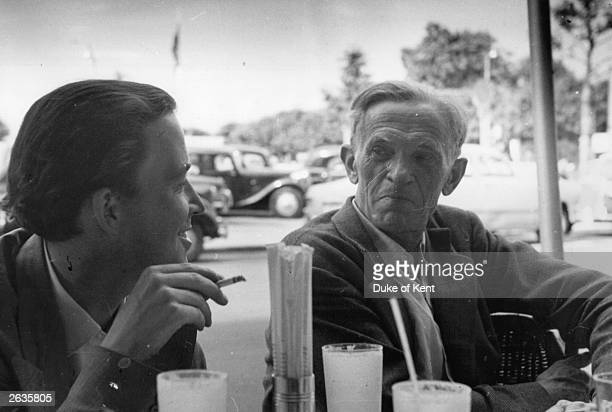 'Picture Post' photographer Kurt Hutton , in a cafe during a business trip to Geneva, with the retained ?fixer/researcher? Alex Koziell. The picture...