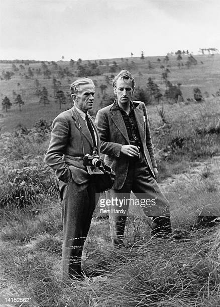 Picture Post photographer Kurt Hutton with editorial staff writer Lionel Birch, September 1948. They are on assignment covering a group of Londoners...