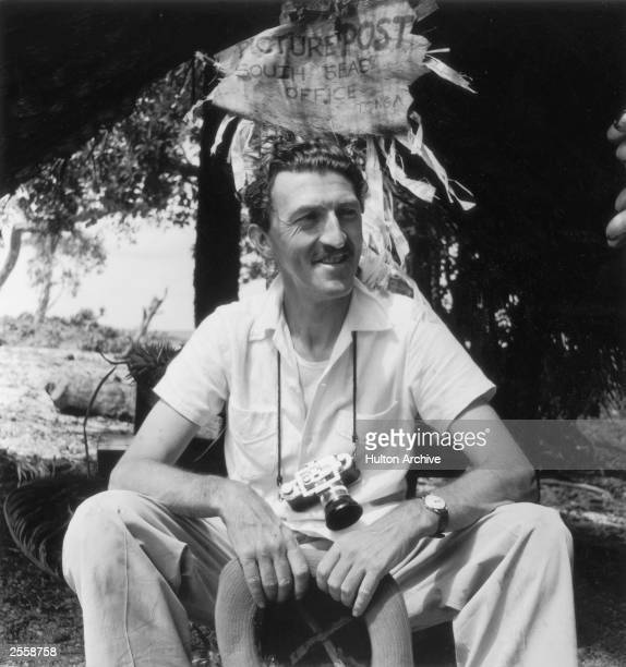Picture Post Photographer Thurston Hopkins in Tonga 26th December 1953 Hopkins is sitting under a homemade sign reading 'Picture Post South Seas...