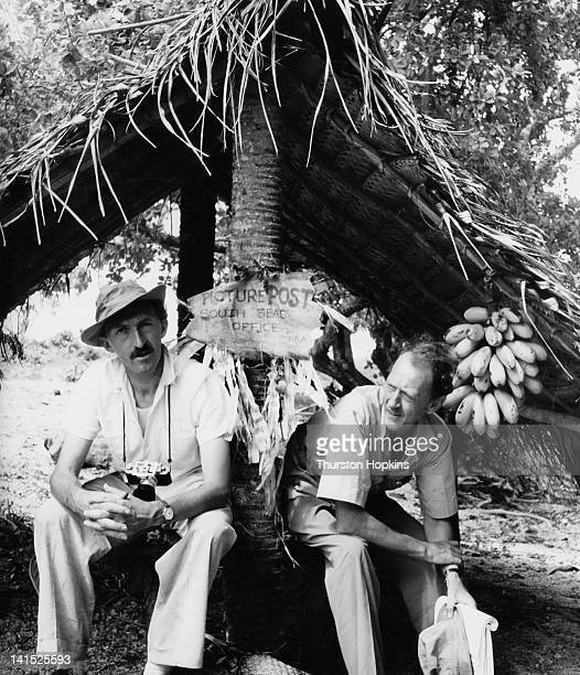 Picture Post photographer Thurston Hopkins with Scottish journalist Fyfe Robertson Tonga 1953 The sign between them reads 'Picture Post South Seas...