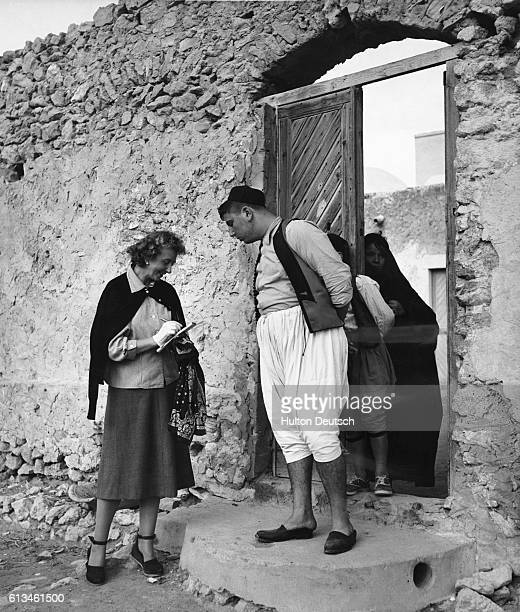 Picture Post reporter Lesley Blanch interviews a Tunisian Jew on the island of Jarbah in the Mediterranean Sea