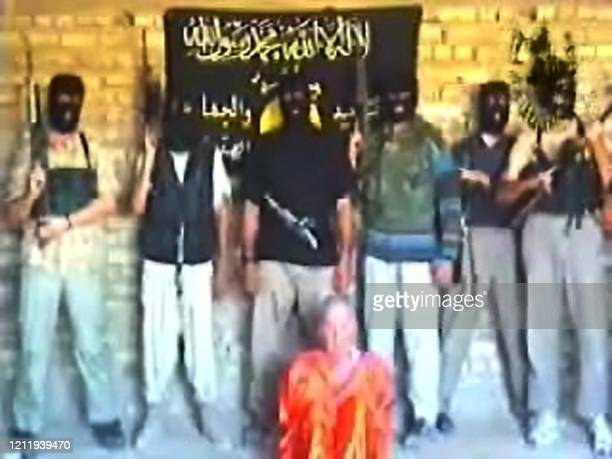Picture posted 10 October 2004 on an Islamist website shows British hostage Kenneth Bigley making a final appeal for Prime Minister Tony Blair to...