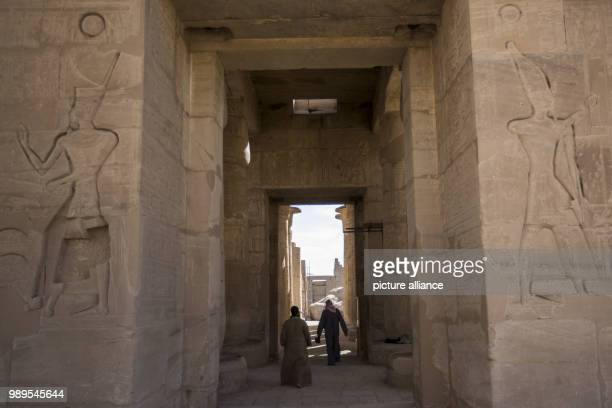 A picture provided on 28 December 2017 shows temple guards walking inside the Ramesseum Temple the memorial temple of Pharaoh Ramesses II in Luxor...