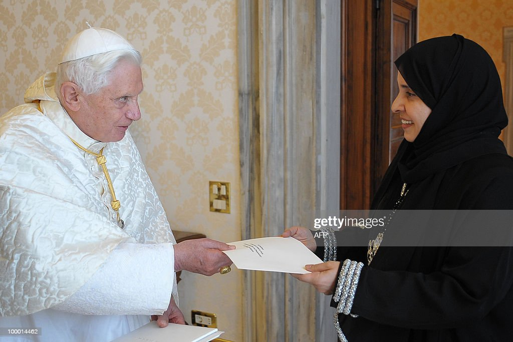 Picture relayed by Osservatore Romano shows Pope Benedict XVI receiving the credentials of Hissa Abdullah Ahmed Al-Otaiba (R), the first ambassador of the United Arab Emirates to the Holy See, at the Vatican on May 20, 2010. AFP PHOTO / Osservatore Romano/ Francesco Sforza