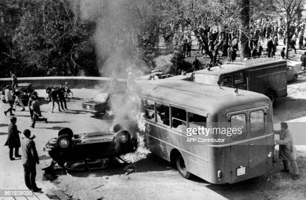 MICHEL A picture released 03 March 1968 shows Italian rioting students burning a police vehicule in Roma during the Battle of Valle Giulia when the...