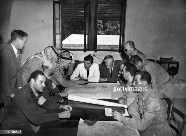 A picture released 06 July 1948 shows Arab and Jewish delegates meeting with the ceasefire Committee to determine their sectors in Jerusalem On...