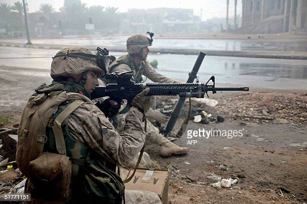 A picture released 21 November 2004 by the Multi National ForceIraq shows marines of the 1st Battalion 8th Marines battle insurgents in the streets...