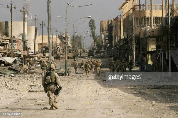 A picture released 23 November 2004 by the Multi National ForceIraq shows members of the Iraqi Special Force patrolling along with marines in the...