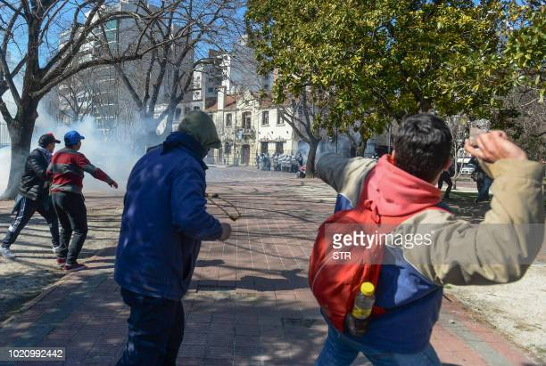 Picture released by AGLP via Noticias Argentinas showing workers from the Astilleros' Rio Santiago shipyard clashing with the police during a protest...
