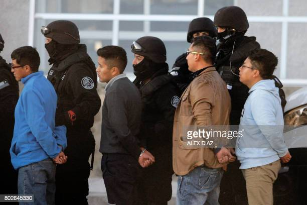 Picture released by Aton Chile showing Bolivian soldiers and customs officials detained on the Chilean side of the border and convicted of robbery...