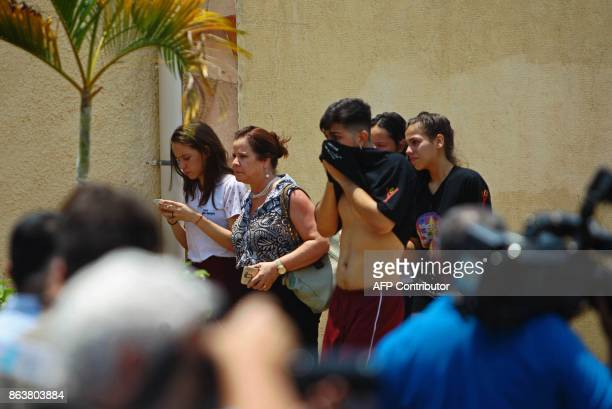Picture released by Brazilian newspaper O Popular showing people reacting at the scene of a shooting at the Goyases private school in Goiania in the...
