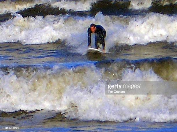 Picture released by Clarence House taken in October 2004 which shows Prince William surfing at St Andrews in Scotland where he is in the last year of...